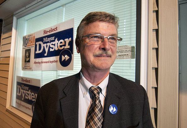 """How curious: When Mayor Paul Dyster campaigned for reelection his motto was """"moving forward together' and he used a fast forward button symbol. Now that he has been reelected Dyster suggests that his department heads have been holding him back."""