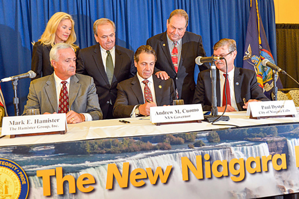 Gov. Andrew Cuomo [center] promised in 2013 a new Niagara. It was tied in part to the tipping point Hamister hotel which has not been built largely because Cuomo's campaign contributor and developer Mark Hamister [left] does not have the financing to build it.  Hamister has inflated the price of the proposed hotel by 100 percent in order to falsely qualify for more taxpayer funding. The new Niagara is much like the old Niagara.