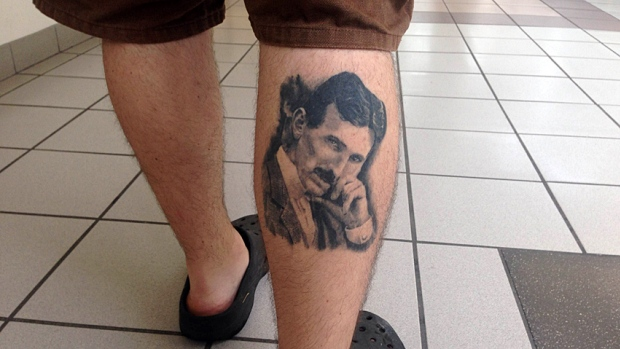 A Hamilton, Ontario resident shows his love for Tesla with an awesome tat.