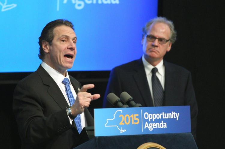 Gov. Cuomo sizes up the share of tourist dollars that will accrue to downtown Niagara Falls businesses after his Niagara Lodge is built in the state park, as his state development honcho, transplanted Brooklynite Howard Zemsky, looks on.