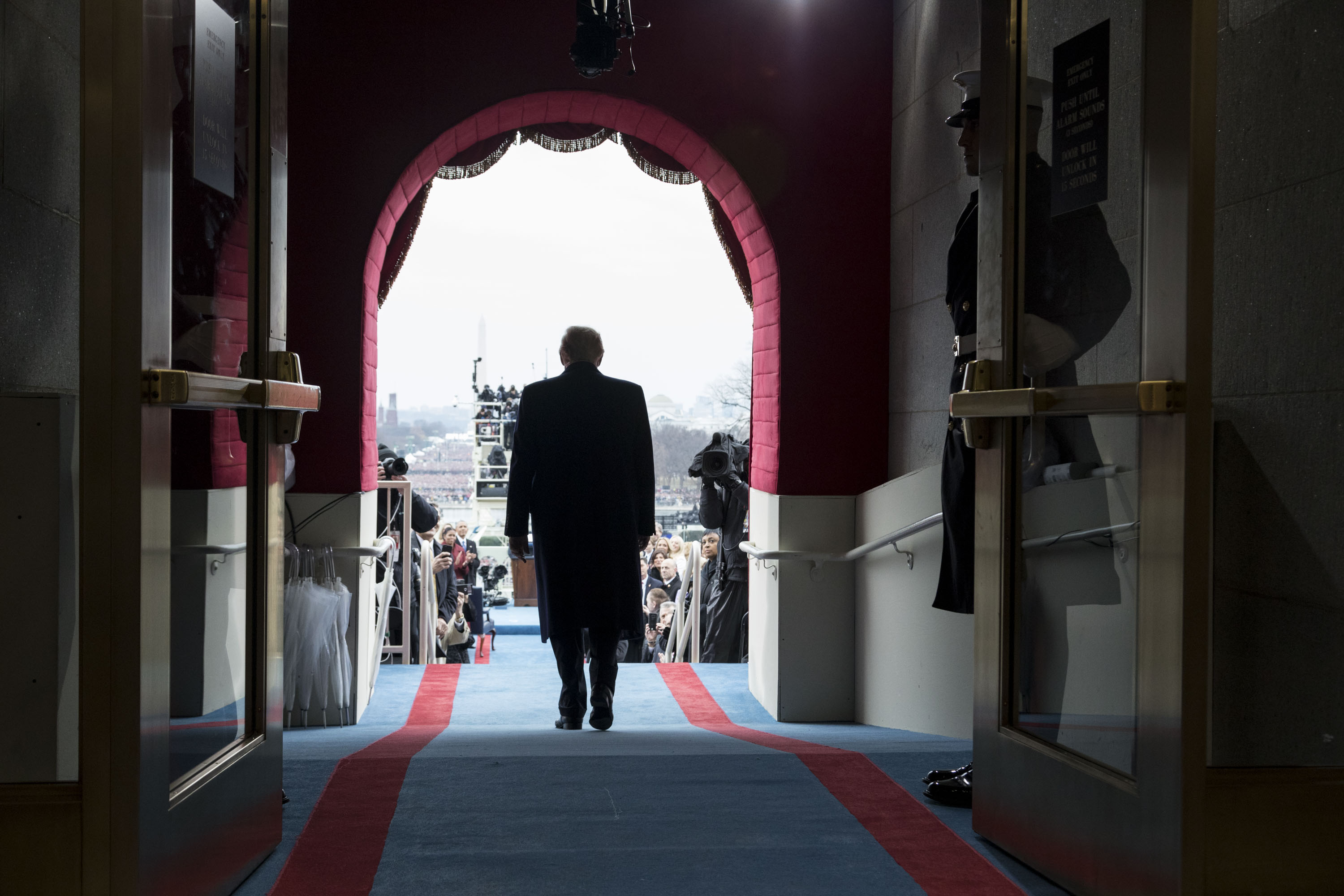 President-elect Donald Trump walks to take his seat for the inaugural swearing-in ceremony at the U.S. Capitol in Washington, D.C., Friday, January 20, 2017. (Official White House Photo by Shealah Craighead)