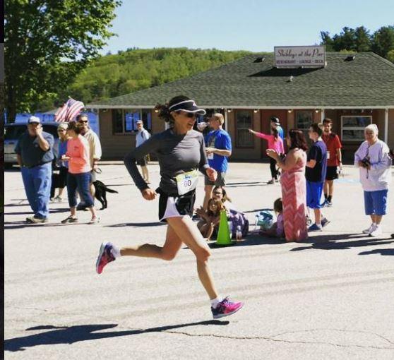 Clare Bronfman completes a half marathon in New Hampshire.