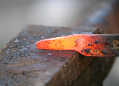 The hot iron burns initials and leaves a lasting scar.