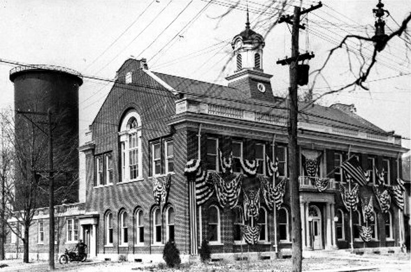 A century ago, the LaSalle Library shared this building with a post office and the village police department. It will soon close its doors two more days a week, due to the city's financial mess.