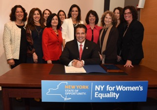 Gov. Andrew Cuomo signs a bill on Oct. 21, 2015 enhancing women's rights at the same time his administration was ignoring reports of women being branded by a cult leader.