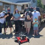 Little Bakery, Wojtaszek, Tompkins and Others Surprise Niagara Falls Resident with Mower, Weed Trimmer