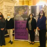 Pictured with the suffrage exhibit, from left to right are:  Niagara County Legislature Chairman Becky Wydysh, Legislator Irene Myers, Legislator Anita Mullane and Mary Brennan-Taylor.